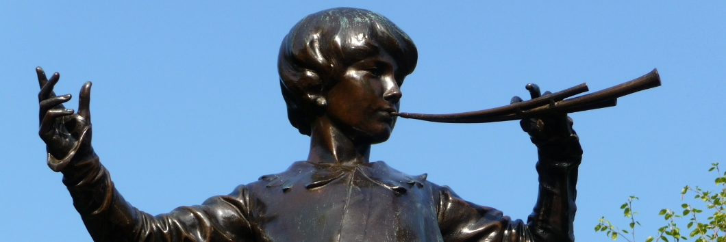 Statue of boy with trumpet